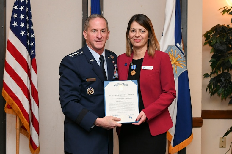 U.S. Air Force Chief of Staff Gen. David L. Goldfein presents the Distinguished Public Service Award to Ms. Wendy Gramza during the Air Force Civic Leader Conference at Joint Base Andrews, Md., Jan. 30, 2020. At the conference, five civic leaders were presented the Distinguished Public Service Award. (U.S. Air Force Photo by Airman 1st Class Spencer Slocum)