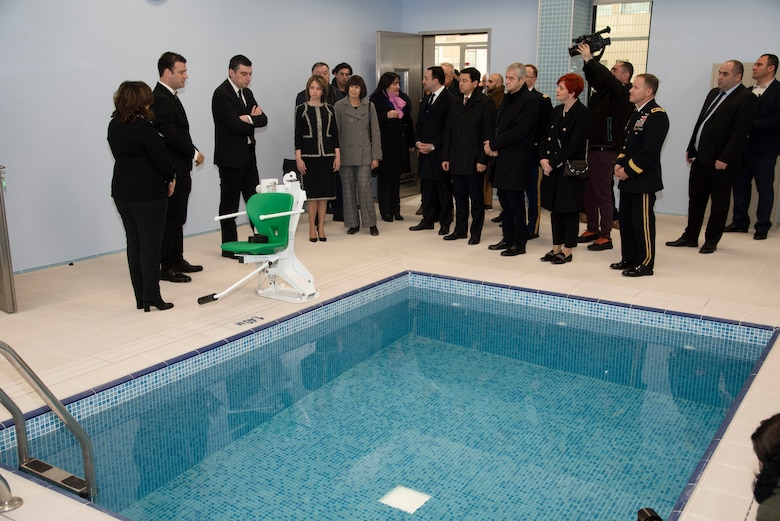 Georgian Prime Minister Giorgi Gakharia, then-Acting U.S. Ambassador Elizabeth Rood, Speaker of the Parliament Archil Talakvadze, and North Atlantic Division Commander Maj. Gen. Jeffrey Milhorn learn about how the facility's aqua therapy pool will be used to help soldiers recover from injuries.  (U.S. Army photo by Chris Augsburger)