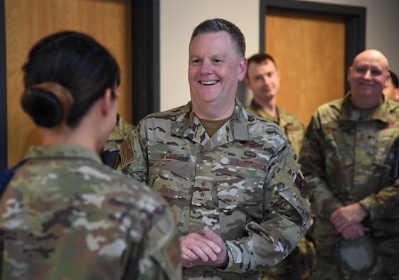U.S. Air Force Lt. Gen. Brad Webb, commander of Air Education and Training Command, shares a laugh with Staff Sgt. Faustina Lai, 336th Training Squadron military training leader, after presenting her with a coin during an immersion tour inside the Levitow Training Support Facility at Keesler Air Force Base, Mississippi, Jan. 30, 2020. The AETC command team visited Keesler to become more familiar with the mission capabilities of the 81st Training Wing and to view the paradigm shift occurring in the training environment within the 81st Training Group. (U.S. Air Force photo by Kemberly Groue)