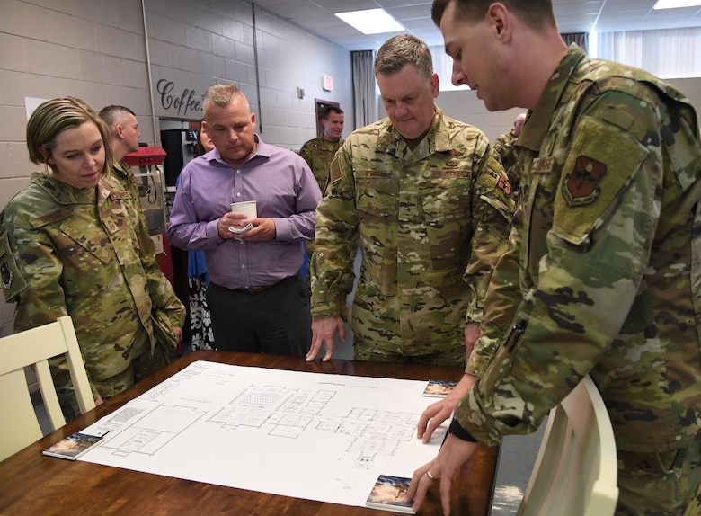 U.S. Air Force Capt. Steven Wichern, 81st Training Wing chaplain, reviews a drawing of The Lighthouse improvements to Lt. Gen. Brad Webb, commander of Air Education and Training Command, and Chief Master Sgt. Julie Gudgel, command chief of AETC, and her husband, Robb Gudgel, during an immersion tour inside the Larcher Chapel at Keesler Air Force Base, Mississippi, Jan. 31, 2020. The AETC command team visited Keesler in order to become more familiar with the mission capabilities of the 81st Training Wing and to view the paradigm shift occurring in the training environment within the 81st Training Group. (U.S. Air Force photo by Kemberly Groue)