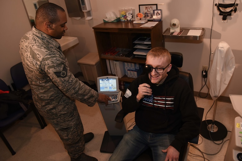 Staff Sgt. Aaron Prevost, 22nd Operational Medical Readiness Squadron NCO-in-charge optometry, performs a routine eye exam on Senior Airman Mitchel Delfosse, 22nd Aircraft Maintenance Squadron electrical environmental system journeyman, Jan. 30, 2020, at McConnell Air Force Base, Kansas. Delfosse visited the 22nd Medical Group to see optometry for a regular checkup. (U.S. Air Force photo by Airman 1st Class Alexi Bosarge)