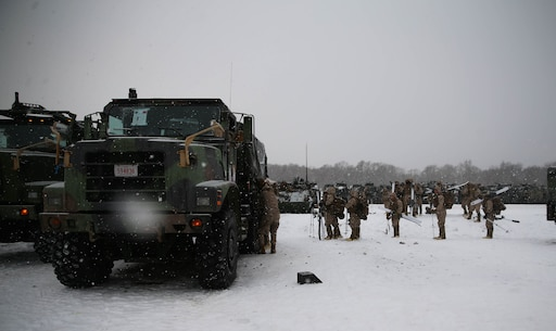 U.S. Marines from Golf Company, 2nd Battalion, 3rd Marine Regiment, 3rd Marine Division, get into 7-ton trucks to move to an area where they can conduct bilateral ski patrol training with Soldiers from 5th Brigade, Japan Ground Self-Defense Force (JGSDF), during exercise Northern Viper on Hokudaien Training Area, Hokkaido, Japan, Jan. 24, 2020. Northern Viper is a regularly scheduled training exercise that is designed to enhance the collective defense capabilities of the U.S. and Japan Alliance by exposing members of both forces to intense training in an austere environment, allowing them to perfect their skills in any clime and place. (U.S. Marine Corps Photo By Cpl. Cameron E. Parks)