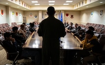Capt. Marcus, 432nd Wing executive officer, teaches Iron Sharpens Iron Mentoring youth about the 432nd Wing's mission during their visit to Creech Air Force Base, Nevada