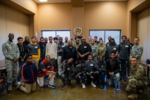 Iron Sharpens Iron Mentoring youth and mentors take a photo together with 432nd Wing volunteers after their mentoring sessions at Creech Air Force Base, Nevada