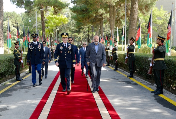 US Army Gen John Nicholson, then commander of Resolute Support Mission and US Forces-Afghanistan, walks with Mohammad Masoom Stanekzai, then director of the National Security Directorate, prior to the start of an Afghanistan Independence Day ceremony at the Ministry of Defense 19 August 2018, in Kabul, Afghanistan.