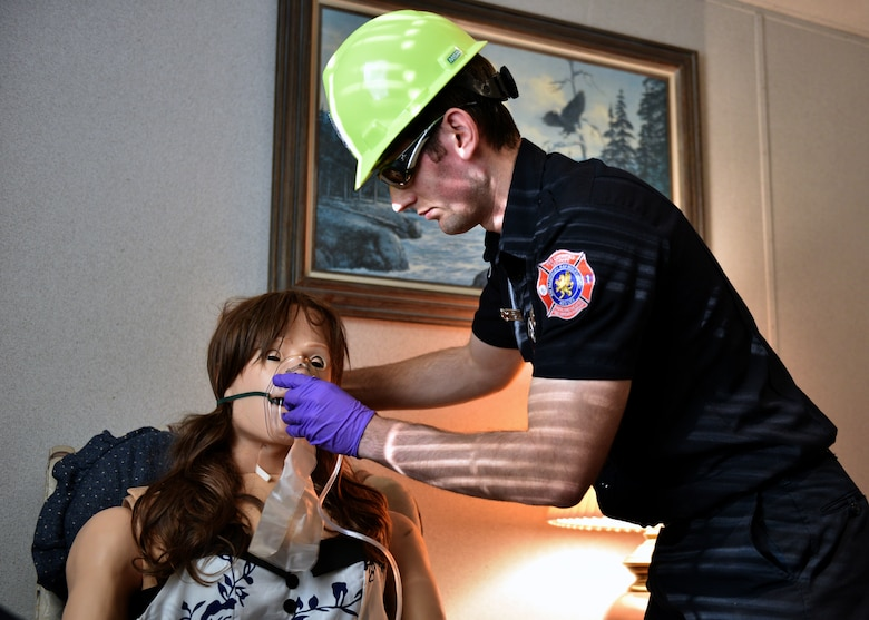 A 312th Training Squadron student provides oxygen to a patient simulated by a HAL Manikin during the Emergency Medical Responders course, Jan. 28, 2020, at the Louis F. Garland Department of Defense Fire Academy on Goodfellow Air Force Base, Texas. These manikins are set up in separate rooms in a simulated apartment building allowing instructors to give students multiple scenarios from a separate control room. (U.S. Air Force photo by Airman 1st Class Robyn Hunsinger)