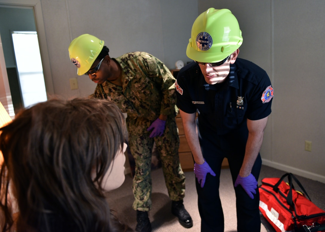 Students from the 312th Training Squadron arrive to a simulated emergency scene during the Emergency Medical Responders course, Jan. 28, 2020, at the Louis F. Garland Department of Defense Fire Academy on Goodfellow Air Force Base, Texas. The EMR course consists of both classroom lecture and hands-on skills training which covers patient assessment, treatment, and use of various medical equipment. (U.S. Air Force photo by Airman 1st Class Robyn Hunsinger)