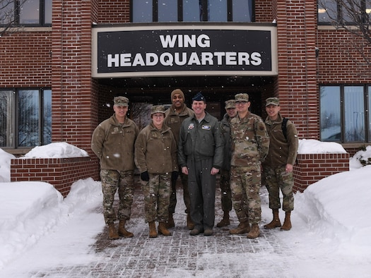 Chief Master Sergeant George Cum, far left, Chief of Medical Enlisted Force, Lt. Gen. Dorothy A. Hogg, second from left, Air Force Surgeon General, and their team, pose for a photo with 319th Reconnaissance Wing leadership at Grand Forks Air Force Base, N.D., Jan. 27, 2020. Hogg and her team were briefed on the 319th Reconnaissance Wing mission, and visited Grand Forks as part of their northern tier base tour. (U.S. Air Force photo by Senior Airman Melody Howley)
