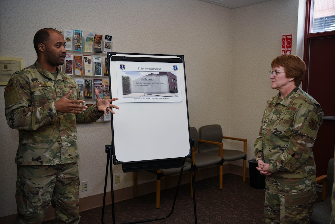 Senior Airman D'andre Willis, left, a public health technician assigned to the 319th Operational Medical Readiness Squadron, briefs Lt. Gen. Dorothy A. Hogg, Air Force Surgeon General, during her tour of the 319th Medical Group at Grand Forks Air Force Base, N.D., Jan. 27, 2020. Willis discussed the current status of public health as well as the accomplishments throughout the facility over the last year. (U.S. Air Force photo by Senior Airman Melody Howley)