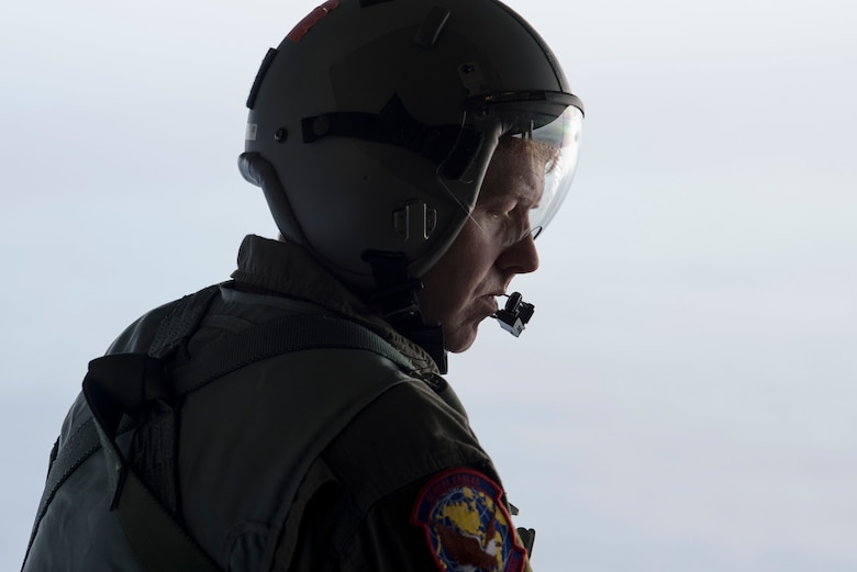 Tech. Sgt. Seth Dunworth, 15th Airlift Squadron loadmaster, prepares to deploy illumination flares and position markers from the ramp of the aircraft during Air Mobility Command Test and Evaluation Squadron's assessment of tactics, techniques and procedures for astronaut rescue and recovery efforts Jan. 22, 2020, off the coast of Florida near Patrick Air Force Base.