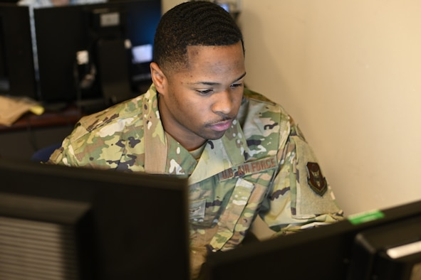 Photo of Airman working at computer.