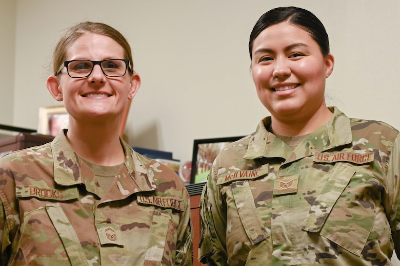 Photo of two Airman smiling.
