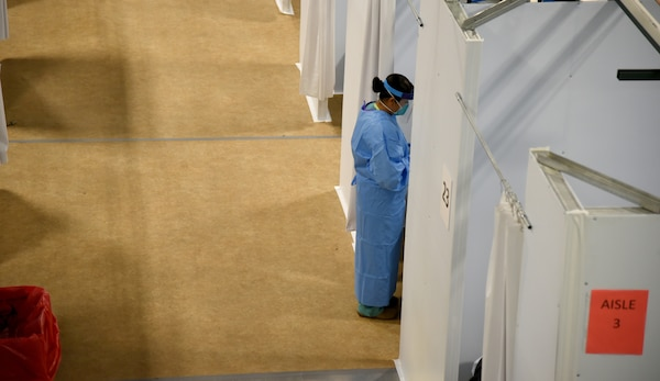 Spc. Paige Curtiss, 253rd Engineer Battalion, food service specialist, speaks to a COVID-19 patient at an alternate care facility on the Navajo Nation in Chinle, Ariz., June 2, 2020. Arizona National Guard service members are assisting the Public Heath Service while they care for COVID-19 patients by providing security and other non-medical tasks.