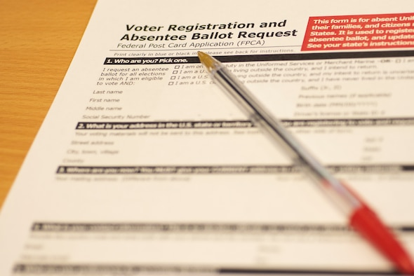 Federal Post Card Applications can be picked up from the Voting Assistance Office at RAF Mildenhall. Airmen can register to vote and request absentee ballots overseas to ensure their voice is heard in elections at home. (U.S. Air Force photo by Airman 1st Class Joseph Barron)