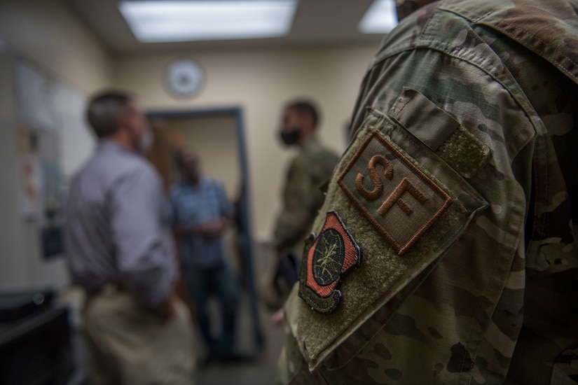 Members of the 628th Security Forces Squadron speak with Col. Marc Greene, 628th Air Base Wing commander, during an immersion brief June 19, 2020 at the Joint Base Charleston Weapons Station, S.C.
