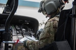 An Indiana National Guard UH-60 Black Hawk pilot conducts pre-flight checks before a combat search and rescue training exercise in Miami County, Indiana on June 18, 2020. The mock scenario utilized a UH-60 Black Hawk helicopter from the Gary Army Aviation Support Facility and multiple A-10C Thunderbolt II fighter jets from the 122nd Fighter Wing, Fort Wayne to prepare guardsmen for the safe retrieval of personnel from a downed aircraft inside hostile territory. (U.S. Air National Guard photo by Staff Sgt. Justin Andras)