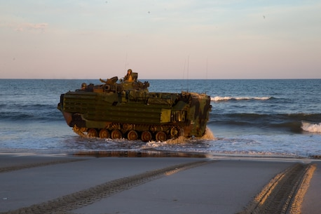 U.S. Marine Corps Lance Cpl. James Bastian, left, and Cpl. Michael Lutz, assault amphibious vehicle crewmen with 3rd Platoon, Bravo Company, 2d Assault Amphibious Battalion, 2d Marine Division, operate an assault amphibious vehicle on Onslow Beach during a three-day ship-to-shore exercise on Camp Lejeune, North Carolina, June 26, 2020. During the exercise, the Marines conducted amphibious maneuvers and dynamic ship-to-shore operations with the USS Wasp (LHD 1). (U.S. Marine Corps photo by Lance Cpl. Jacqueline Parsons)