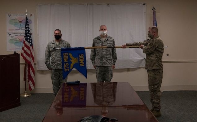U.S Air Force officers stand behind guidon