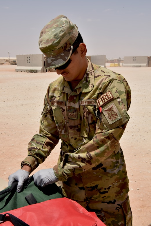 Medic Airmen from the 378th Expeditionary Medical Squadron train during a heat injury, rapid cool protocol exercise with firefighters from the 378th Expeditionary Civil Engineer Squadron at Prince Sultan Air Base, Kingdom of Saudi Arabia, July 1, 2020. Rapid response time to heat injuries is crucial for life-saving treatment for a patient. (U.S. Air Force photo by Master Sgt. Benjamin Wiseman)