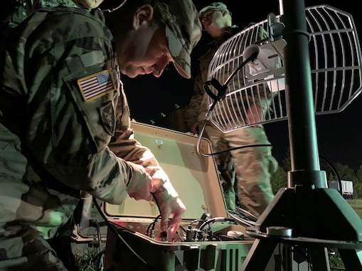 Pulling an all-nighter - Members of the Army Cyber Institute demonstrate the capabilities of their High Frequency technology and equipment to Mr. Adam Nucci, HQDA Cyber, during Cyber Blitz.