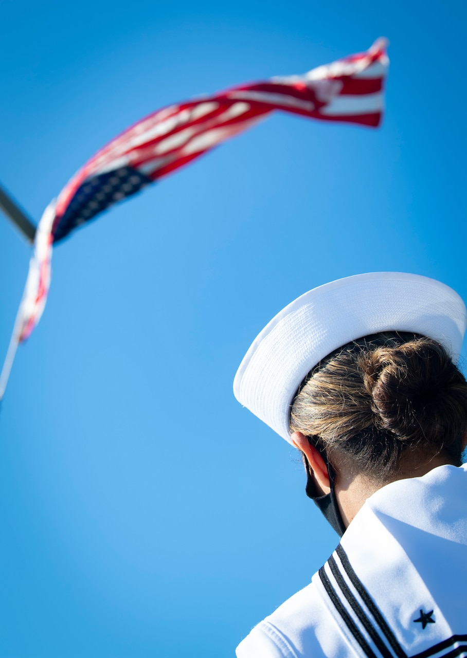 200701-N-BM428-0034 GAETA, Italy (July 1, 2020) Cryptologic Technician (Technical) Seaman Elizabeth Hall, assigned to the Blue Ridge-class command and control ship USS Mount Whitney (LCC 20), salutes the American Flag as it is raised during colors aboard the ship as the ship returns to homeport in Gaeta, Italy, July 1, 2020. Mount Whitney is the U.S. 6th Fleet flagship, homeported in Gaeta, and operates with a combined crew of U.S. Sailors and Military Sealift Command civil service mariners. (U.S. Navy photo by Mass Communication Specialist 2nd Class Damon Grosvenor)