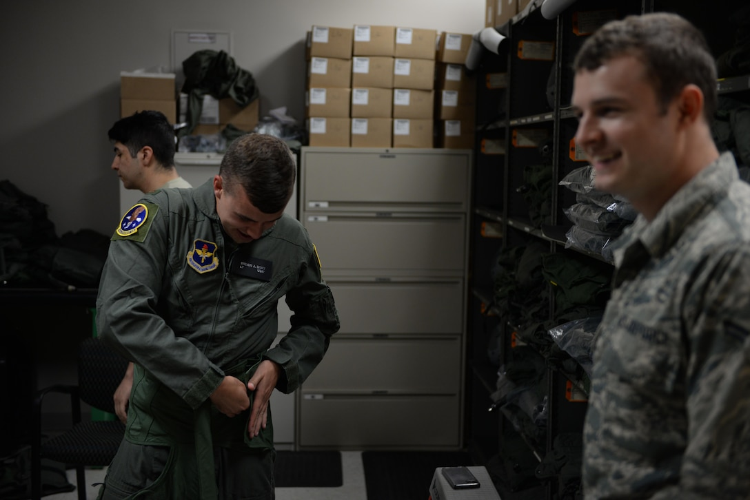Second Lt. Steven Britt, 37th Flying Training Squadron student pilot, puts on a G-suit at Columbus Air Force Base Miss. Even with 2,600 flying hours and 741 combat hours, the challenge of bringing in students and creating world-class aviators can't be understood without PIT. (U.S. Air Force photo by Airman 1st Class Davis Donaldson)