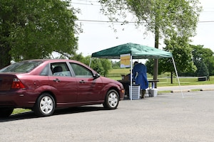 A local community member pulls up to a testing pod at the drive-thru COVID-19 testing site June 17, 2020 at Community Building Institute in Middletown, Ohio. Airmen from the 178th Wing and Soldiers assigned to the Ohio National Guard augmented staff members of Centerpoint Health to help with drive-thru Coronavirus testing of local community members. (U.S. Air National Guard photo by Staff Sgt. Amber Mullen)