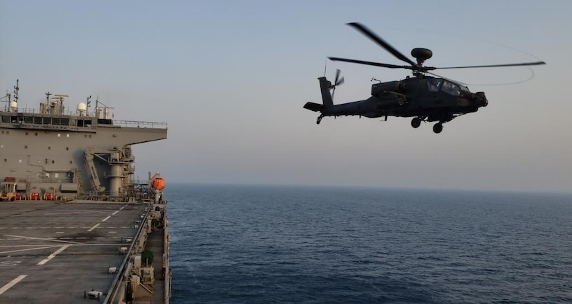 ARABIAN GULF (June. 25, 2020) A AH-64D Apache helicopter attached to the United Arab Emirates Joint Aviation Command, launches from the flight deck during flight operations aboard the expeditionary sea base USS Lewis B. Puller (ESB 3) June 25, 2020. Lewis B. Puller is deployed to the U.S. 5th Fleet area of operations in support of naval operations to ensure maritime stability and security in the Central Region, connecting the Mediterranean and Pacific through the Western Indian Ocean and three critical chokepoints to the free flow of global commerce. (U.S. Navy photo by Chief Logistics Specialist Thomas Joyce)