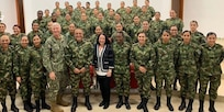 Ambassador Jean Manes, joined by U.S. Southern Command Commander Admiral Craig S. Faller, Colombian Army General Luis Navarro and Colombian Army Major General Eduardo Zapateiro, meets with a group of active duty women soldiers from the Colombian Army.