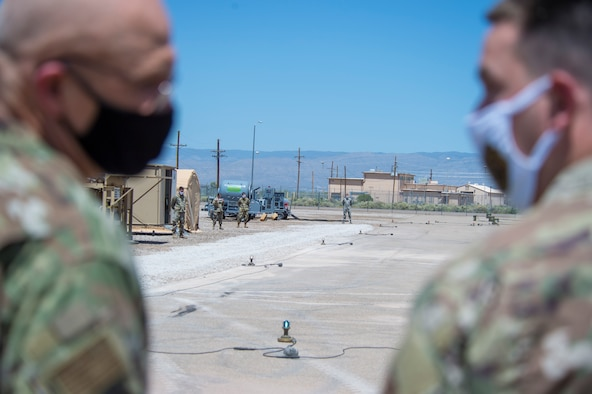 Airmen with the 635th Materiel Maintenance Group wait to give Gen. Arnold W. Bunch Jr., Air Force Materiel Command commander, a tour of Basic Expeditionary Airfield Resources Base, June 29, 2020, on Holloman Air Force Base, N.M. Bunch's tour included meeting with various Airmen across the installation to see how their mission remained successful despite challenges derived from the global COVID- 19 pandemic. (U.S. Air Force photo by Senior Airman Collette Brooks)
