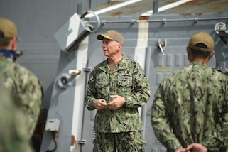 dm. Craig S. Faller talks to the crewmembers of  USS Lassen and USS Farragut.