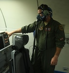 U.S Air Force Staff Sgt. Daniel Propst, 961st Airborne Air Control Squadron air surveillance officer, checks the oxygen masks onboard an E-3 Sentry before flight April 27, 2020, at Kadena Air Base, Japan. Propst has the distinction of being the first noncommissioned officer in Pacific Air Forces to qualify as an ASO. The ASO position is historically been a rated aircrew commissioned officer only, typically a Captain or a Major.