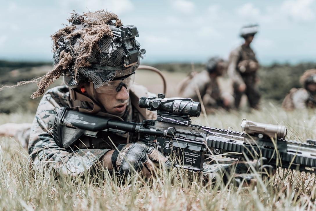 A U.S. Marine observes targets downrange during live-fire maneuver drills on Camp Schwab, Okinawa, Japan, June 18.