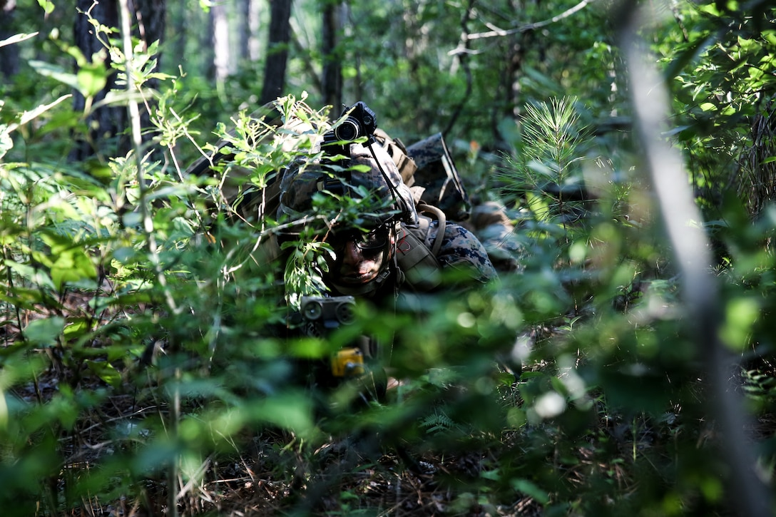 A U.S. Marine posts security during an airfield assault and seizure simulation at Marine Corps Outlying Landing Field, Camp Davis, N.C., June 9.