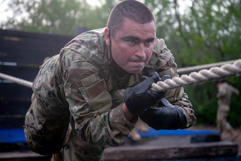 Jesus Hughes, U.S. Air Force basic training trainee, runs through an obstacle course May 21 at Joint Base San Antonio-Chapman Annex.