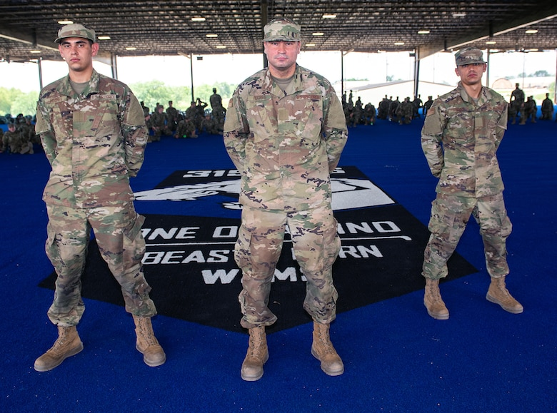 Daniel (left), Jesus (center), and Nicolas (right) Hughes, U.S. Air Force basic training trainees, pose for a photo after the BEAST graduation ceremony May 21 at Joint Base San Antonio-Chapman Annex.