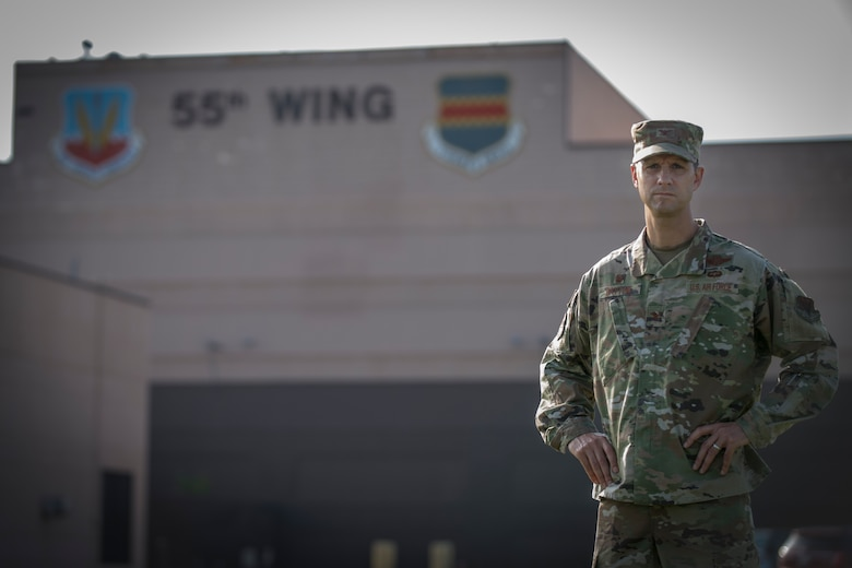 Military member stands in front of Building D
