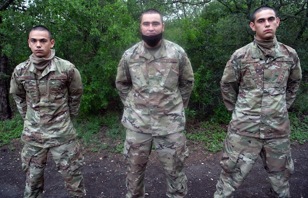 Daniel (left), Jesus (center), and Nicolas (right) Hughes, U.S. Air Force basic training trainees