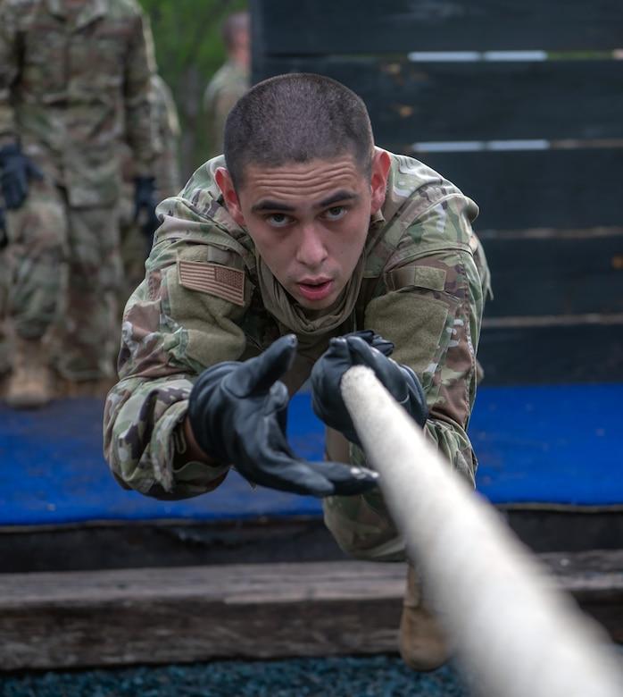 Daniel Hughes, U.S. Air Force basic training trainee, runs through an obstacle course May 21 at Joint Base San Antonio-Chapman Annex.