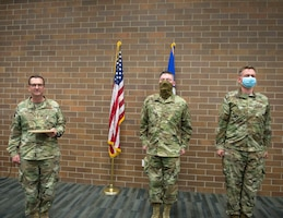 U.S. Air Force Tech. Sgt. Kyle Sovde, center, and Staff Sgt. Tyson Schnitker from the 133rd Medical Group were recognized by U.S. Air Force Gen. Joseph L. Lengyel, Chief of the National Guard Bureau, for their work during the COVID-19 and civil unrest State Active Duty assignments in St. Paul, Minn., June 17, 2020.