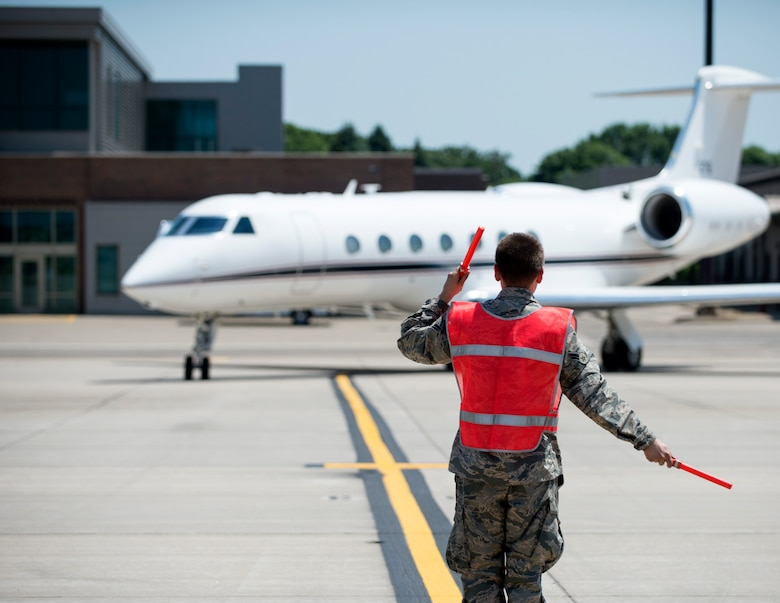 U.S. Air Force Airman from the 133rd Aircraft Maintenance Squadron marshals U.S. Air Force U.S. Air Force Gen. Joseph L. Lengyel, Chief of the National Guard Bureau, aircraft into position in St. Paul, Minn., June 17, 2020.