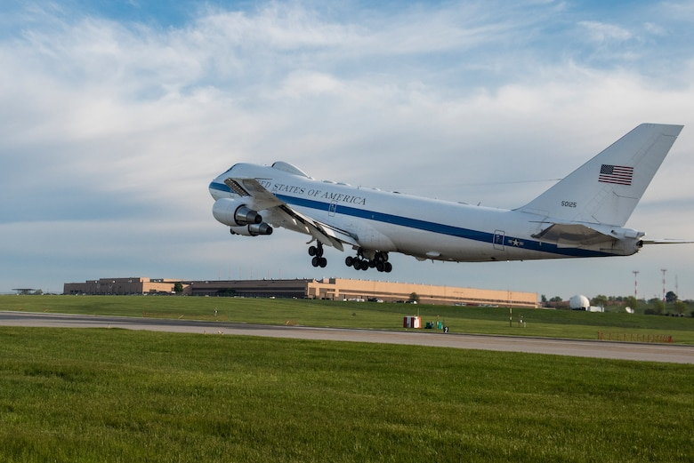 An E-4B takes off over Building D