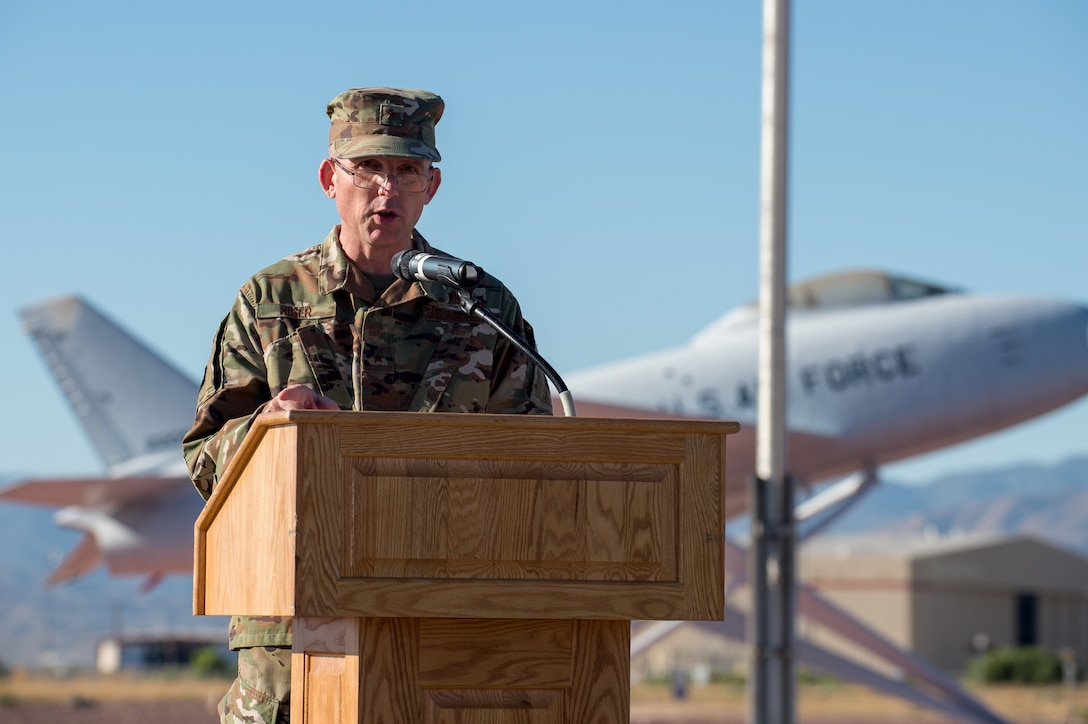 Brig. Gen. Matthew Higer, 412th Test Wing Commander, provides remarks during a Change of Leadership Ceremony between Col. Dwayne Robison and Dr. David Smith at Operating Location Air Force Plant 42, in Palmdale, California, July 1. (Air Force photo by Ethan Wagner)