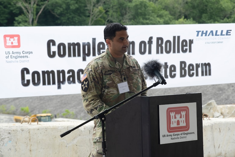 Lt. Col. Sonny Avichal, U.S. Army Corps of Engineers Nashville District commander, addresses guests at the Center Hill Lake Auxiliary Dam July 1, 2020 during a ceremony celebrating the completion of the last phase of repairs for the $353 million Center Hill Dam Safety Rehabilitation Project. The U.S. Army Corps of Engineers Nashville District recently finished constructing a roller compacted concrete berm to reinforce the auxiliary dam at Center Hill Lake, a secondary earthen embankment that fills a low area in the landscape just east of the main dam. (USACE Photo by Lee Roberts)