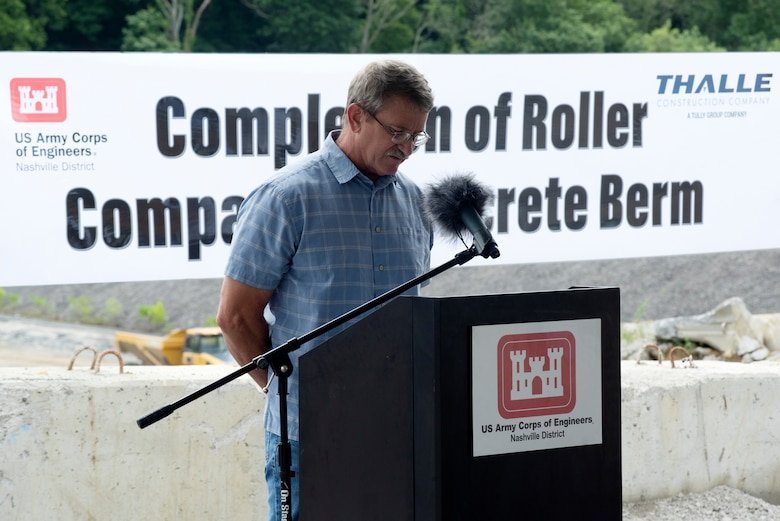Corps of Engineers Retiree Tony Crow gives the invocation July 1, 2020 to a ceremony celebrating the completion of the last phase of repairs for the $353 million Center Hill Dam Safety Rehabilitation Project. The U.S. Army Corps of Engineers Nashville District recently finished constructing a roller compacted concrete berm to reinforce the auxiliary dam at Center Hill Lake, a secondary earthen embankment that fills a low area in the landscape just east of the main dam. (USACE Photo by Lee Roberts)