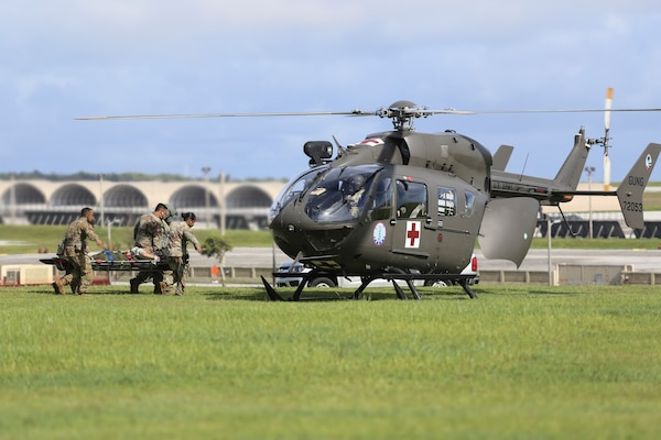 Soldiers from the Guam National Guard load a medical evacuation patient into a Lakota helicopter at Andersen Air Force Base on June 30. The Guard supported Operation Spartan Flex to exercise joint capabilities in the Indo-Pacific Command Region.
