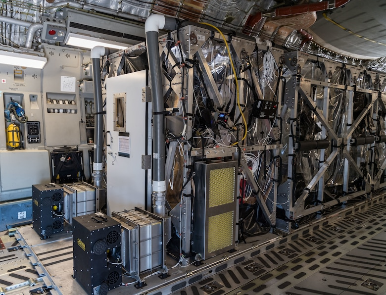 A Transport Isolation System unit used to transport COVID-19 patients is positioned on a C-17 Globemaster III, June 26, 2020, at Dover Air Force Base, Delaware. Two TIS units are located at Dover, which serves as the U.S. East Coast hub due to its location and support facilities. (U.S. Air Force photo by Roland Balik)
