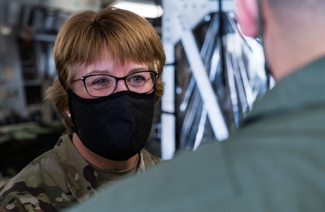 Lt. Gen. Dorothy Hogg, U.S. Air Force surgeon general, speaks with a 10th Expeditionary Aeromedical Evacuation Flight aircrew member June 26, 2020, at Dover Air Force Base, Delaware. Dover serves as the U.S. East Coast hub for the Transport Isolation System. (U.S. Air Force photo by Roland Balik)