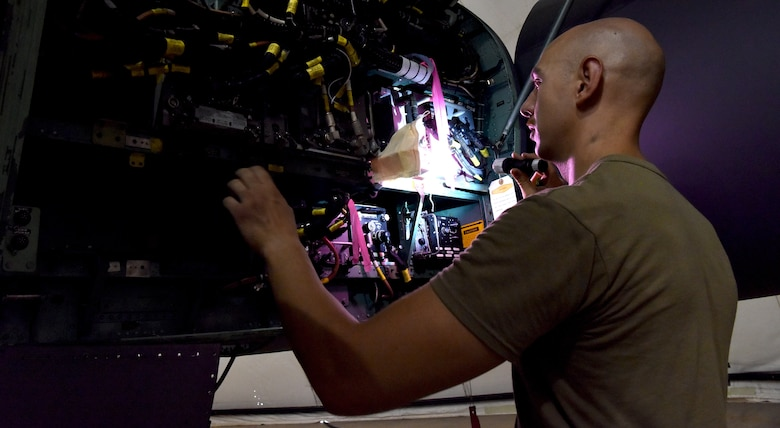 .S. Air Force aircraft maintenance Airmen from the 378th Expeditionary Maintenance Squadron execute aircraft maintenance inspection on an F-15C Eagle aircraft at Prince Sultan Air Base, Kingdom of Saudi Arabia, June 30, 2020.