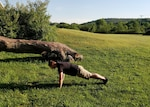 Dan Roberts demonstrates a plank exercise, which can easily transition into a pushup, burpee or vertical jump.
